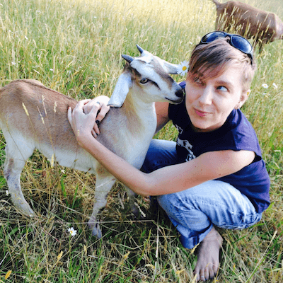 Sharing a hug with a goat friend